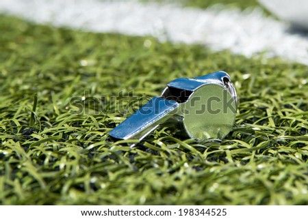 Whistle on a soccer field - stock photo