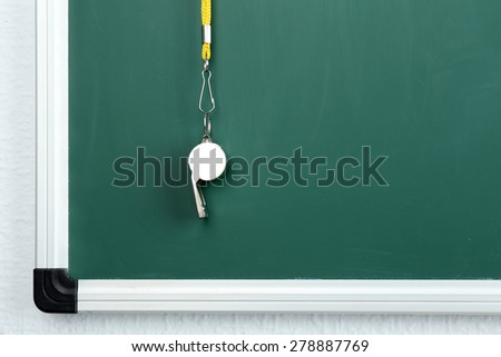 Whistle on blackboard background - stock photo