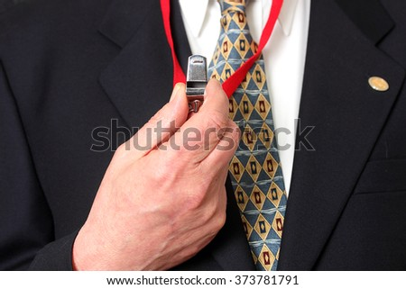 Whistleblower concept, Caucasian man holding whistle highlighting corruption - stock photo