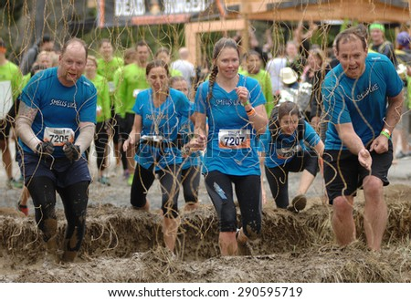 WHISTLER, CANADA - JUNE , 2015: Competitors participate in the 2015 Spartan Race obstacle racing challenge in Vancouver, Canada, on June 20, 2015. - stock photo