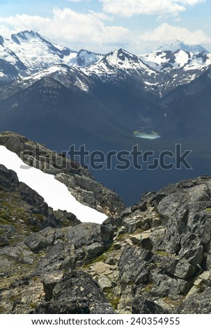 Whistler landscape with mountain and lake. British Columbia. Canada. Vertical - stock photo