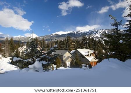 Whistler Village with mountains and ski slopes-runs - stock photo