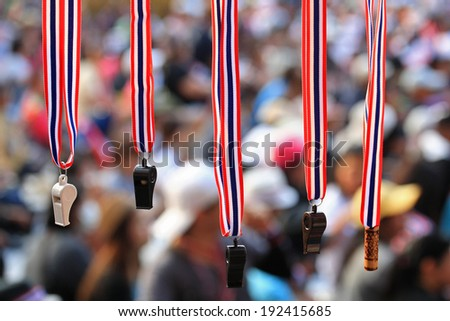 Whistles with Thailand  flag lanyard hanging for sale at Thai rally - stock photo