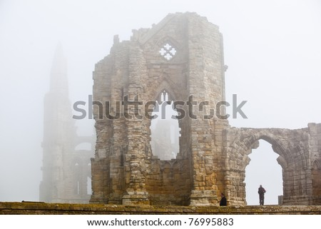 Whitby Abbey castle shrouded in fog a ruined Benedictine abbey sited on Whitby's East Cliff in North Yorkshire on the north-east coast of England.UK