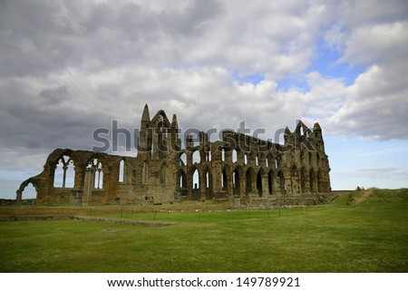 Whitby Abbey is a ruined Benedictine abbey overlooking the North Sea on the East Cliff above Whitby - stock photo