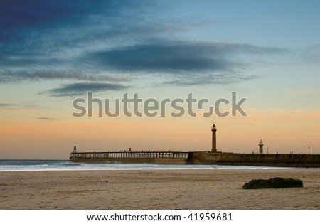 Whitby beach and pier - stock photo