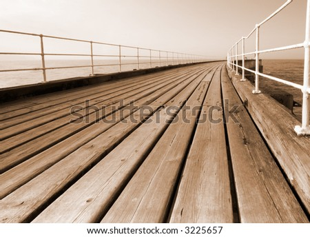 Whitby pier in sepia - stock photo