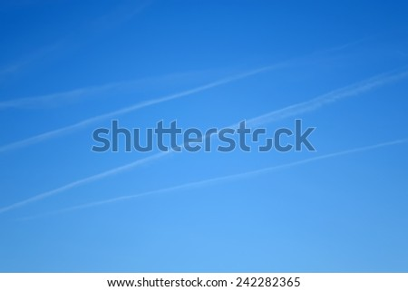 white abstract stripes on  blue sky - stock photo