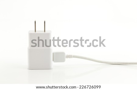 White adapter Charger with usb cable on white background - stock photo