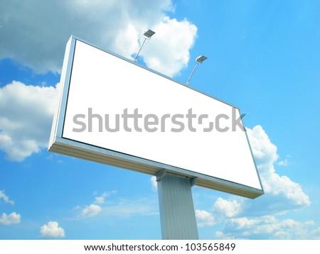 White advertisement hoarding against the blue sky - stock photo