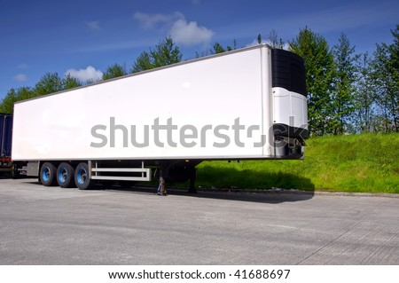 white air conditioned truck trailer for haulage transporting - stock photo