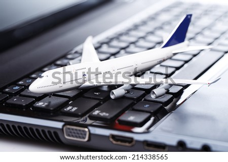 White aircraft over laptop keyboard