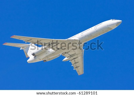 White Airplane in the blue sky - big passenger airliner taking off - stock photo