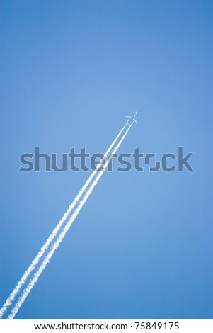 White airplane trace on blue sky - stock photo