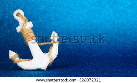 white anchor isolated in a blue glistening backdrop - stock photo
