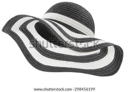 white and black beach hat on white background - stock photo