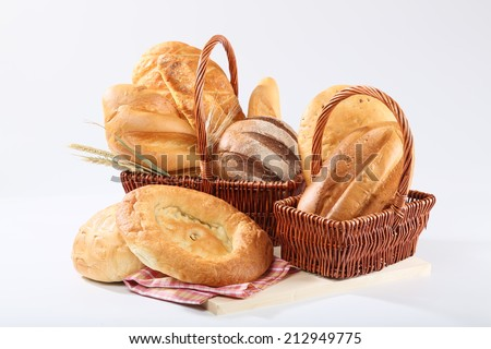 White and black bread in basket - stock photo