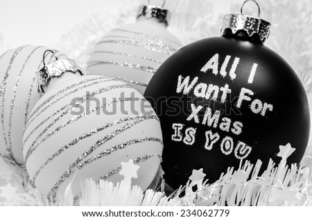 White and black Christmas tree balls - All I want for Xmas is you - stock photo