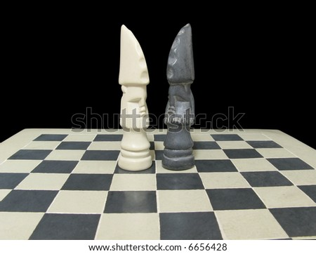 White and black king (face-to-face) on a chessboard isolated on a black background