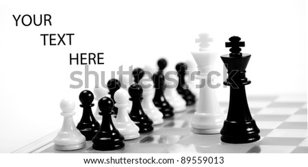 White and black king on the chessboard opposing each other,black and white pawns in the background,can be used as concept for conflict, meeting, agreement.. - stock photo