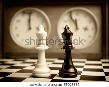 White and black king on the chessboard opposing each other,old chess clock in the background,sepia toned,can be used as concept for conflict,meeting,agreement.. - stock photo