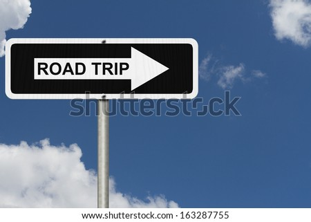 White and Black street sign with sky background with word Road Trip , Road Trip  Sign