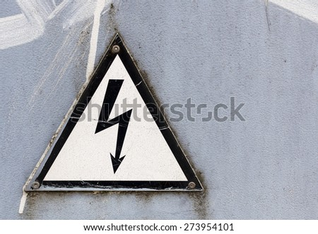 White and black warning sign on gray background - stock photo