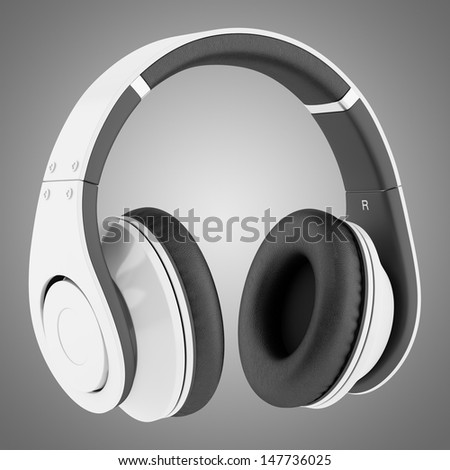 white and black wireless headphones isolated on gray background - stock photo