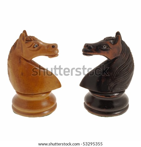White and black, wooden chess horses against a white background - stock photo
