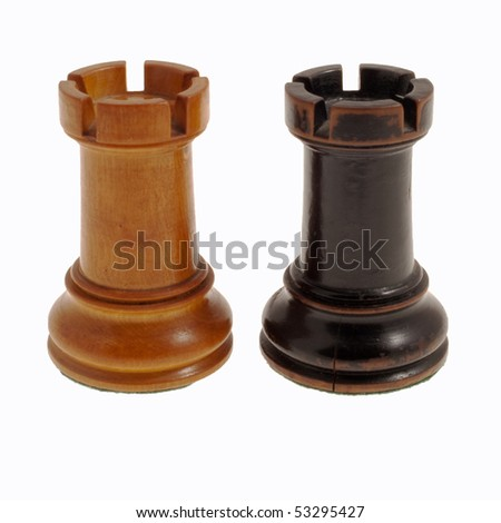 White and black, wooden chess towers against a white background - stock photo