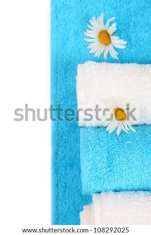 White and blue bath towels with daisies