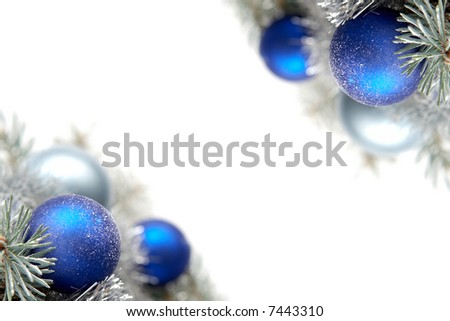 White and blue bulbs covered with snow and spruce twigs - stock photo