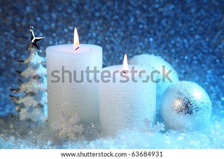 White and blue christmas decoration on snow background - stock photo