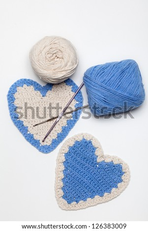 White and Blue Crochet Knitted Hearts - stock photo