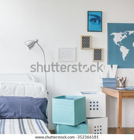 White and blue designed teen boy bedroom - stock photo