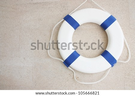 White and blue lifebuoy on  wall. - stock photo