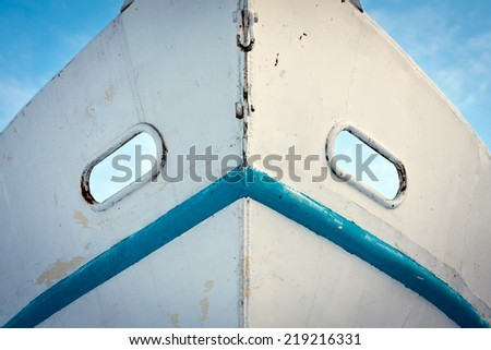White and blue metal fishing boat nose - stock photo