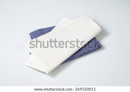 white and blue napkins on white background