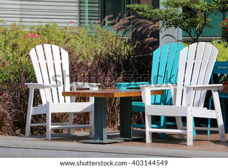 white and blue outdoor restaurant seating for three people - stock photo