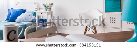 White and blue room for someone young