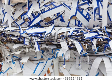 White and blue scrap cardboard on the landfill of waste paper