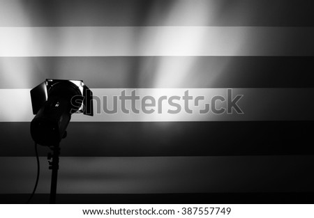 White and bright shape created on the wall with studio light flashes - stock photo