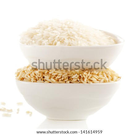 White and brown rice isolated on white. Selective focus - stock photo