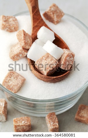 White and brown sugar on the table