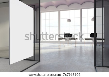 White and glass office interior with a concrete floor and computer tables with white chairs and blank displays. A poster. 3d rendering mock up