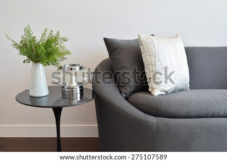 white and gray decorative pillow on a casual sofa in the living room - stock photo