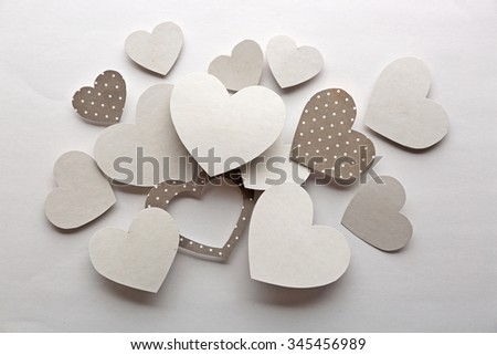 White and gray hearts on white paper  background