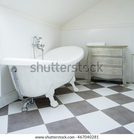 White and gray tiles in modern bathroom