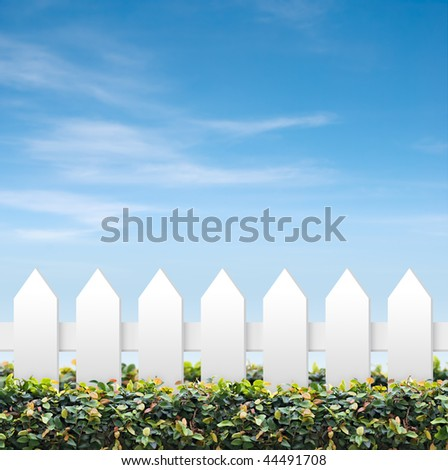 White and green fences shot against blue sky