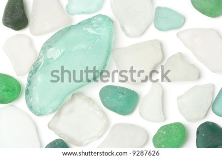 White and green glass sea wasted stones isolated on white. - stock photo